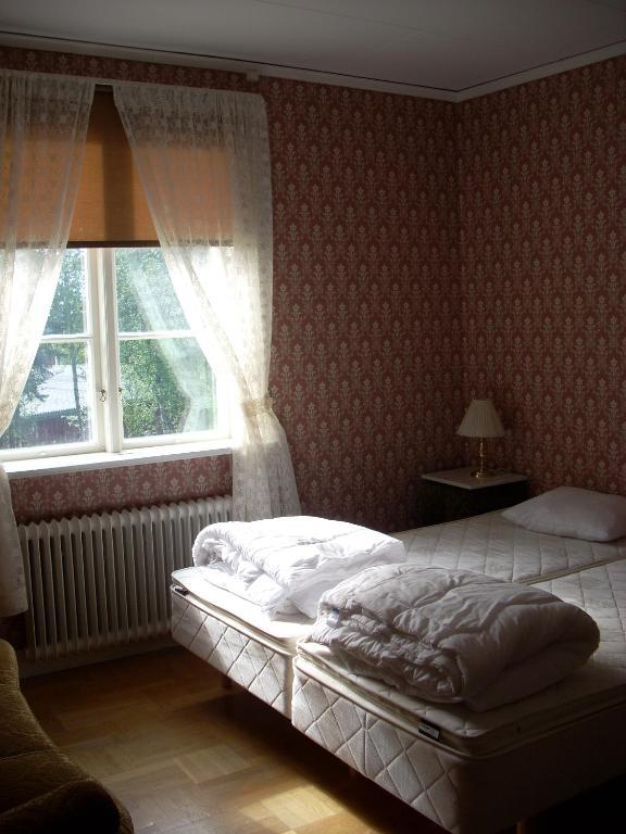 Å-hemmet Dikanäs sovrum